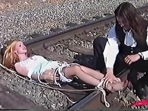 Ticklish Damsel Tickled on Railroad Tracks (nylon unfold feet tickling)