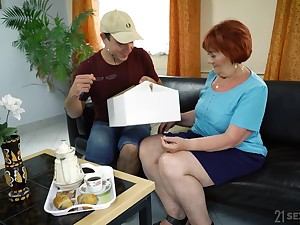 Dirty grown up redhead Marsha gives BJ and gets pounded doggy style